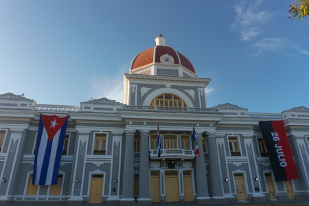 cienfuegos, cuba. City Hall with cuban and part Flags on facade during celebration of 1 january. Stock Photo