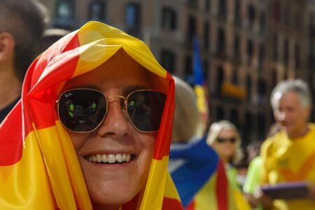 Barcelona, Catalonia, Spain, September 11, 2017: People on street on riot during national day from Catalonia claming for independence of Catalunya in Barcelona with catalan flags. Editorial caption Editorial