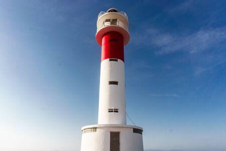 Close up of Far del Fangar lighthouse. Into Natural Park of Delta de lebre, Tarragona, Catalonia.