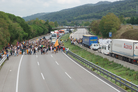 Cardedeu, Catalonia, Spain, October 3, 2017: paceful people cutting off the highway AP-7 in protest for spanish police repression of first october Editorial