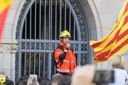 Granollers, Catalonia, Spain, October 3, 2017: paceful people and firemfighters in protest against spanish police intervention of 1 october in catalonia referendum.