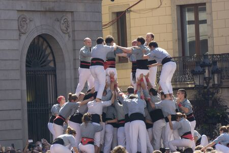 Barcelona, Catalonia, September 24, 2017: Castellers during La Merce celebration in Barcelona. In plaza Sant Jaume, in city hall. 報道画像