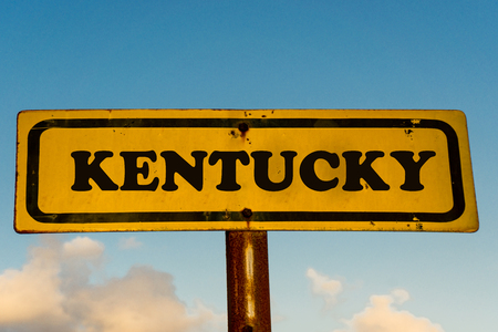 Kentucky state street on antique old yellow sign with blue sky at background, USA signal state series.
