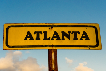 Atlanta city street old antique yellow sign with blue sky at background, USA signal city series.