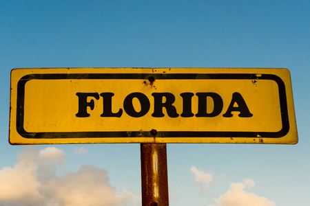 Florida state street on antique old yellow sign with blue sky at background, USA signal state series.