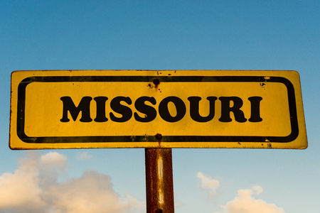 Missouri state street on antique old yellow sign with blue sky at background, USA signal state series. Stock Photo