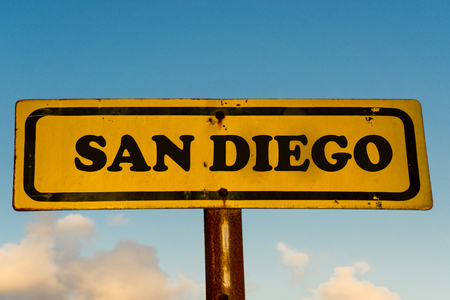 San Diego city street old antique yellow sign with blue sky at background, USA signal city series.
