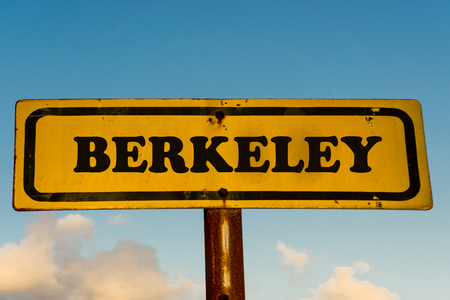 Berkeley city street old antique yellow sign with blue sky at background, USA signal city series.