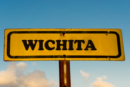 Wichita city street old antique yellow sign with blue sky at background, USA signal city series.