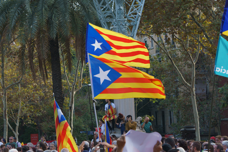 Barcelona, Catalonia, Spain, October 10, 2017: flags and people on rally support for independence of Catalunya or Catalonia in Passeig Lluis Companys. Editorial