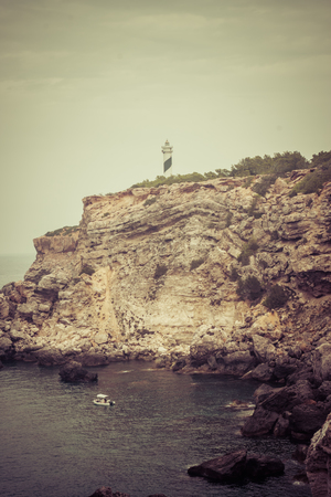 View of the Moscarter lighthouse on the northwest coast of the island of Ibiza, Balearic Islands, Spain 스톡 콘텐츠