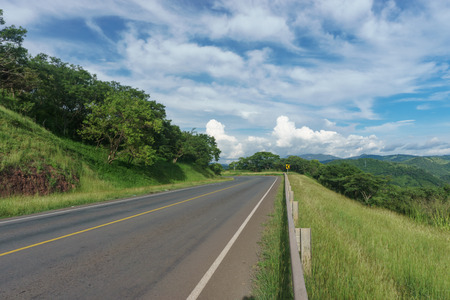 road view with beautiful sky in green mountain, road trip travel concept Stock fotó