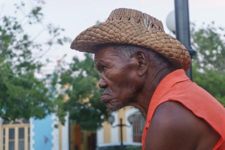 Trinidad, Cuba, January 3, 2017: old man on street smooking a cigar