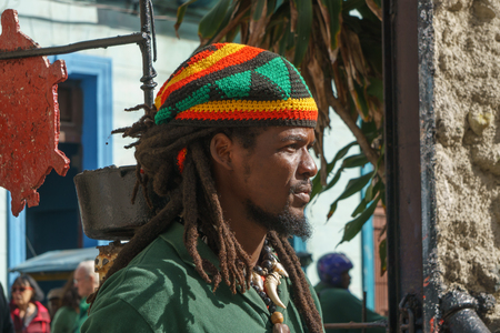 La Havana, Cuba, January 08, 2017: afrocaribbean and rasta street culture in Callejon de Hamel in La Havana. There is a famous street by rasta and black culture in La Havana Editorial