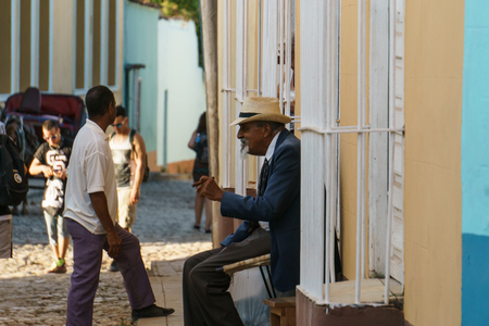 Trinidad, Cuba, January 3, 2017:  old man on street smooking a cigar