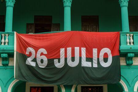 Santa Clara, Cuba, January 5, 2017: Flag of cuban party on balconery Imagens