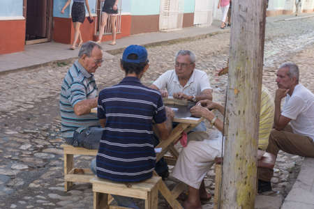 Trinidad, Cuba, January 3, 2017:  men playing domino on street