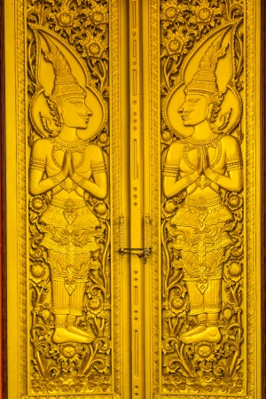 gold door of temple at thailand photo