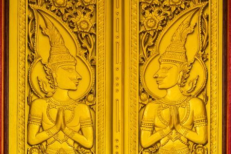 Lai Thai gold door of temple at thailand photo