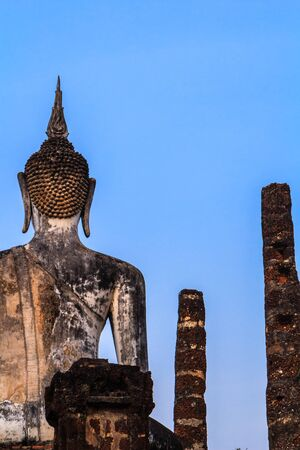 Buddha Statue in Wat Mahathat Temple in Sukhothai Historical park at sunrise, Thailand photo