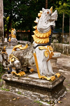 The sculpture of Singha (lion) in a temple in the northern of Thailand photo