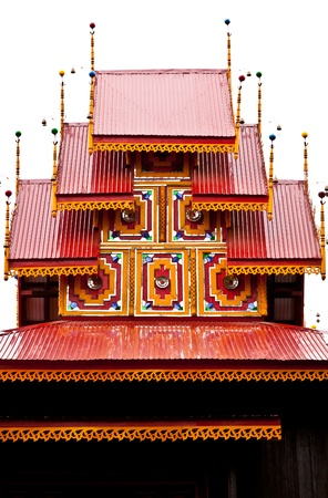 The top of Myanmar style roof of Wat Sri Rong Muang, Lampang province, Thailand