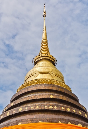 The Golden Pagoda at Phra That Lamgang Luang Temple, Lampang Province, Thailand photo