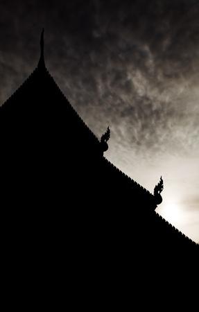 vihara: The silhouette of the vihara in Phra Singha temple, Chiang Mai province, Thailand Stock Photo