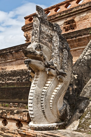 snakes and ladders: Nagas guarding a stairway to the Chedi Luang stupa, Chedi Luang temple, Chiang Mai province, Thailand