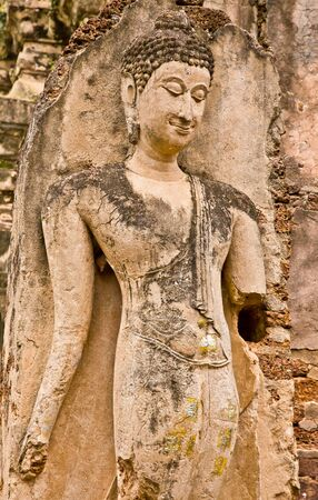The ruins of a beautiful standing image of Buddha in a temple, Sukhothai province, Thailand Stock Photo - 11882680
