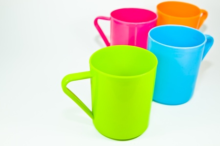 The close up image of colorful plastic cups with the white background