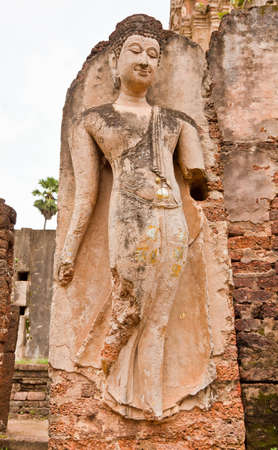 The ruins of a beautiful image of Buddha, Sukhothai province, Thailand Stock Photo - 12660552