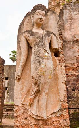The ruins of a beautiful image of Buddha, Sukhothai province, Thailand Stock Photo - 12660552
