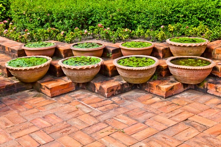 Eight pots for growing aquatic plant decorated in a garden