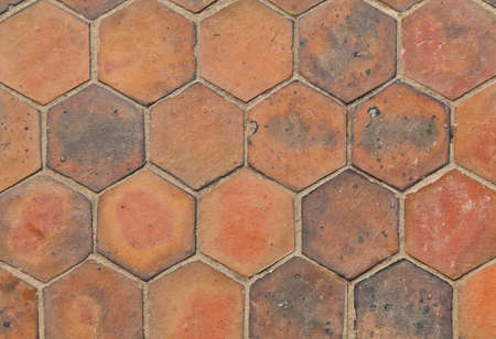 The closeup background image of hexagonal clay tiles photo