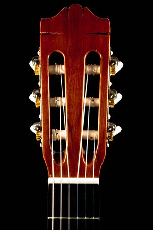 The closeup image of the head of a classical guitar