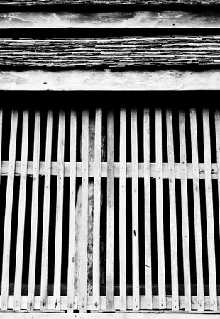 The black and white image the wooden wall of a Lanna style house, Chiang Mai province, Thailand photo