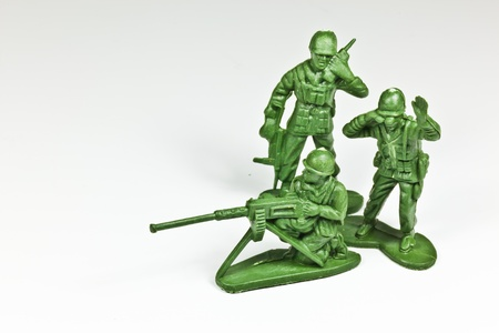 green plastic soldiers: The isolated image of the plastic toy soldiers