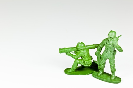 green plastic soldiers: The isolated image of two plastic toy soldiers Stock Photo