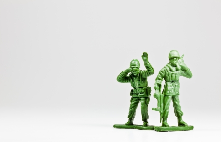 toy soldier: The isolated image of two green plastic toy soldiers Stock Photo