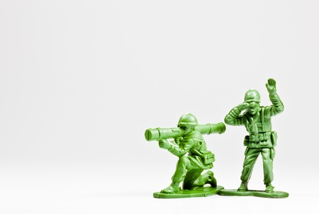 plastic soldier: The isolated image of two green plastic toy soldiers Stock Photo