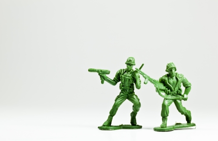 The isolated image of two green plastic toy soldiers Stock Photo - 13174525