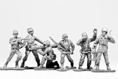 The black and white image of a group of plastic toy soldiers photo