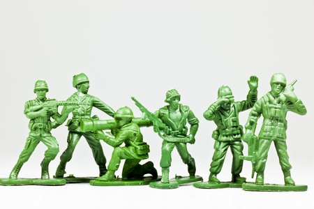 toy soldier: The isolated image of a group of green plastic toy soldiers Stock Photo