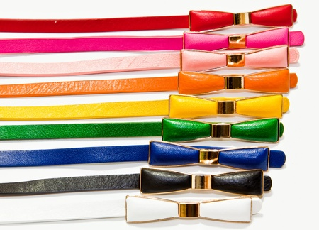 The closeup image of the arranged lady colorful leather belts photo