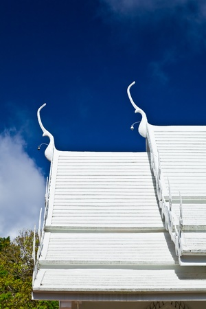 The top of Thai style roof at Wat Phra That Doi Tung, Chiang Rai province, Thailand Stock Photo - 13539136