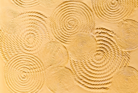 The background image of the yellow textured cement wall