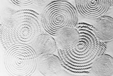 The black and white background image of the textured cement wall