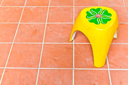 The colorful chair on the tiled floor Stock Photo