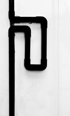 The black and white image of the pvc pipe on the wall photo